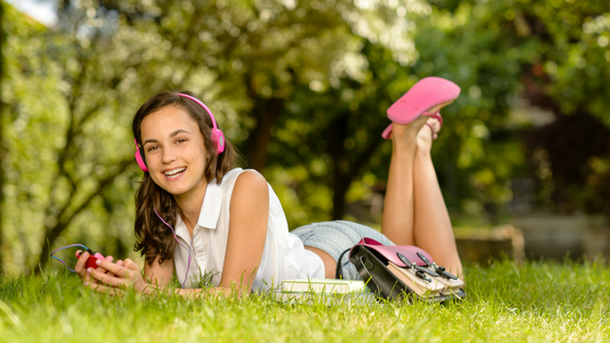 Girl-with-headphones-and-books